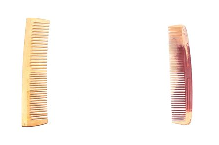 Wooden and plastic hair combs lie opposite each other on a white background Stok Fotoğraf - 132120170
