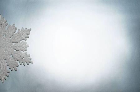 Decorative snowflake lies on a silver background Archivio Fotografico - 132388754