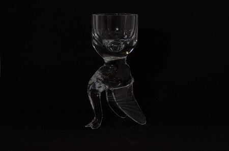 crystal glass on delivery in the form of a goose close-up on a black background Archivio Fotografico - 132120084