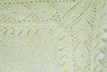 fragment of knitted warm shawl pattern close up background