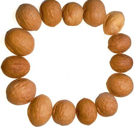 round walnut shell frame isolated on white background Stok Fotoğraf