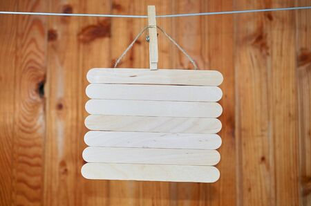 hanging signboard board on wooden background horizontal format