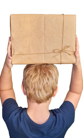 a boy in a blue t shirt stands backwards and holds a cardboard box above his head isolated on a white background Stok Fotoğraf