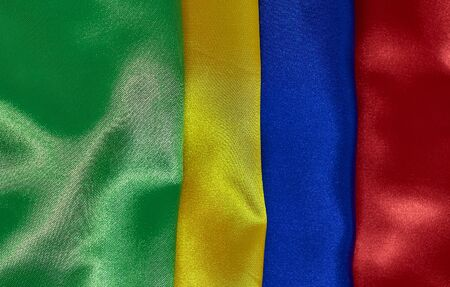 background of red, blue, yellow, green satin fabric with pleats Stok Fotoğraf
