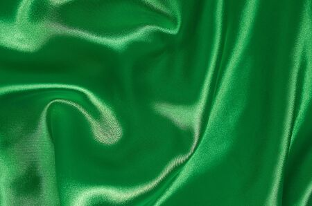 background of satin green fabric in pleats horizontal format