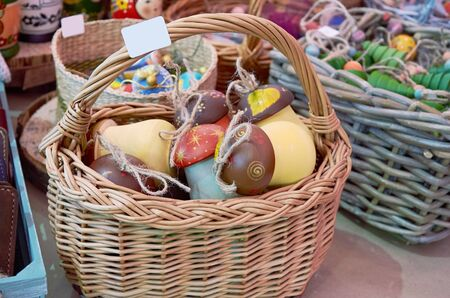 wooden toy mushrooms with a handmade rope lie in a basket at the fair