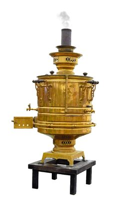 an old copper samovar with a chimney from which smoke comes stands on a small table isolated on a white background