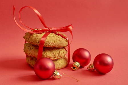 Round cookies with cereals and seeds tied with a red ribbon on  red