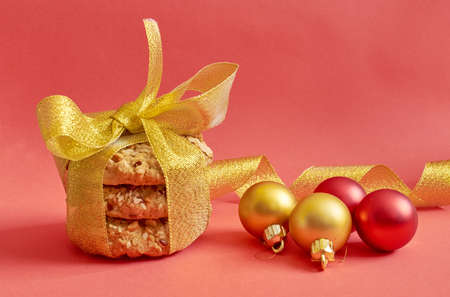 Round cookies with cereals and seeds tied with a gold ribbon on  red