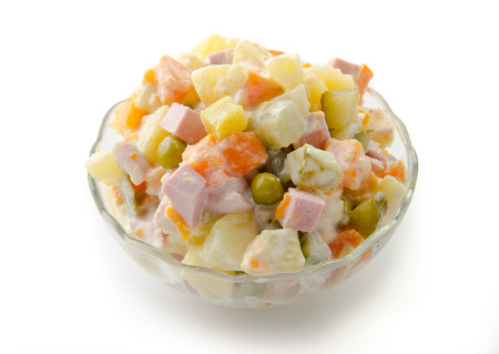 white russian: Russian traditional salad olivie isolated on white bacground with clipping path.
