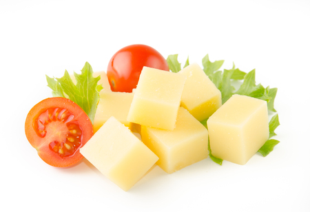 cheese cubes with tomatoes isolated on white background