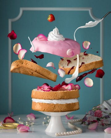 confectionary: Bakery. Confectionary. Flying cake. Creamcheese, cream, jam, dessert, concept, abstraction. Stock Photo