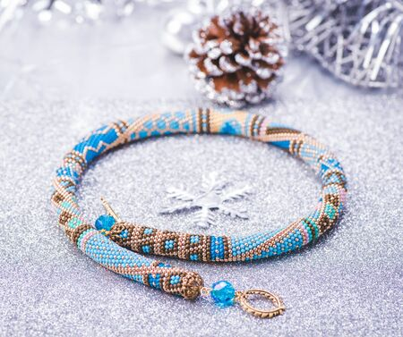 Beadwork. Beaded necklace. Winter. Jewelry. Top view. Stock Photo
