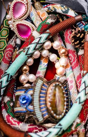 Handmade beaded jewelry. Macro. Selective focus. Top view.