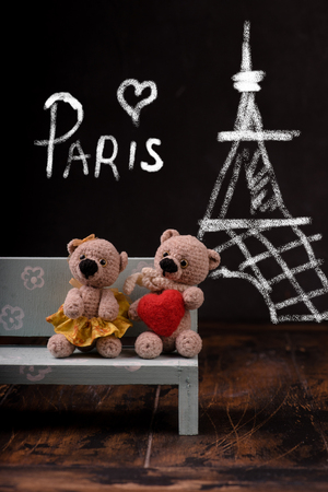 Valentines Day. Love heart. Paris. Couple Teddy Bears. Handmade toys. An offer of marriage. Vintage retro romantic style. Family, wedding and friendship. Chalkboard with chalk.