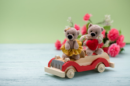 Valentines Day. Love heart. Couple Teddy Bears on the car. Handmade toys. An offer of marriage. Vintage retro romantic style. Family, wedding and friendship Stock Photo