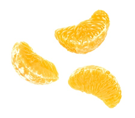 clementine fruit: Isolated tangerine or clementine fruit on white background. Macro. Slice of mandarin. Top view.