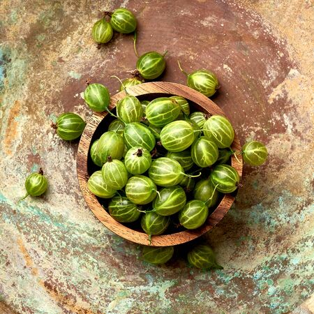 Gooseberries on an abstract background. Top view. Life style. Stock Photo