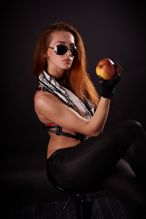 Girl in sunglasses with Apple in the Studio
