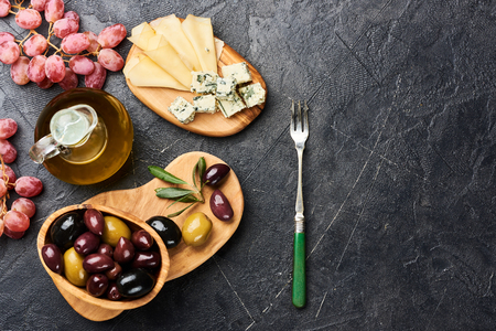 Italian snacks food with Cheese, Olives, Oil with copy space. Top view. Stock Photo