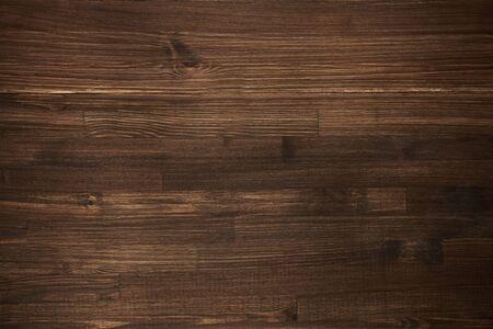 Dark wooden background. Autentic board. Top view.