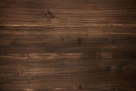 Dark wooden background. Autentic board. Top view.