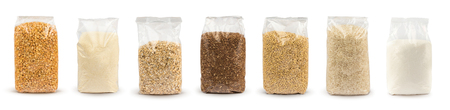 Set of Plastic transparent bags with full of groats isolated on white background. Packages with peas, semolina, rice, seeds, buckwheat grain, oat flakes, sugar. Mockup. Foto de archivo