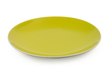 Green dinner plate isolated on white background