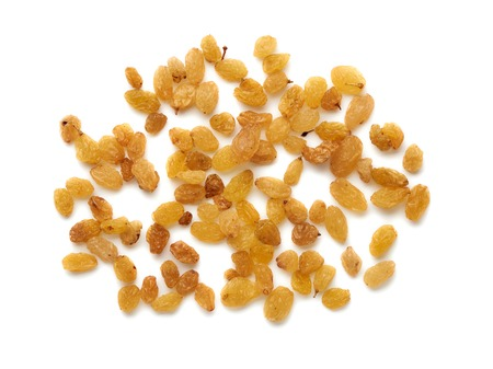 Yellow raisins isolated on white background. Top view. Stock fotó