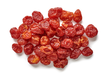 Heap of dried cherry tomatoes isolated on white background. Top view. Stock Photo