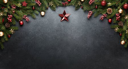 Christmas Star on black New Year banner. Xmas presents with decoration and fir branches on black background. 写真素材