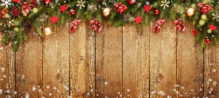 Christmas wooden banner with decoration and fir tree. Snow and light. View with copy space. Reklamní fotografie