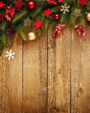 Christmas wooden background with decoration and fir tree. View with copy space.