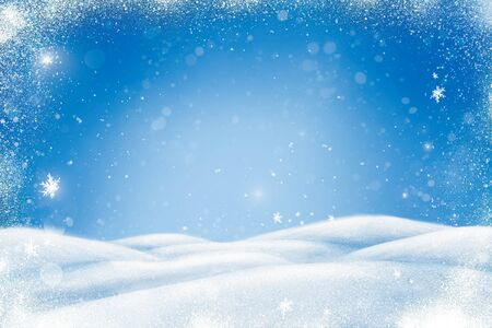 Winter Christmas landscape with snow, snowdrifts and snowfall. Blue background with copy space for your text.