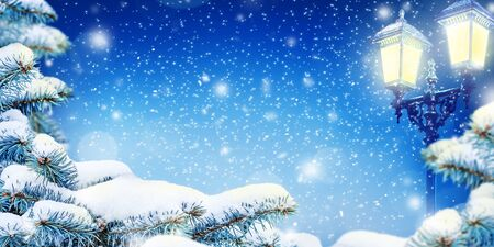 Winter Christmas Night background with snow, snow drifts, lamps and snowfall. Dark blue background with copy space. Reklamní fotografie