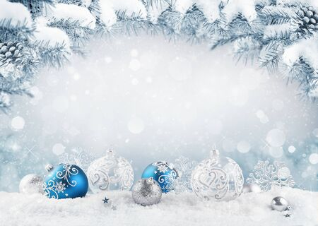 Merry Christmas card. Blue christmas balls and baubles on the snow with fir branches. Reklamní fotografie