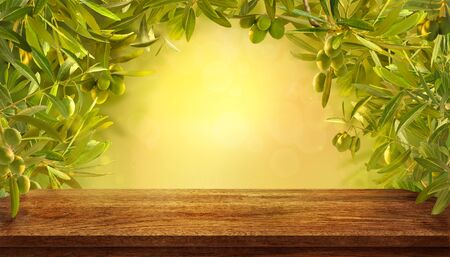 Mockup of empty table with olives branches with fresh olives on yellow background. Standard-Bild - 133062403