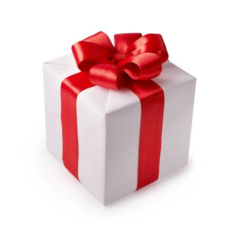 Beautiful white gift box with red bow. Happy Womens Day or Christmas and New Years Day.