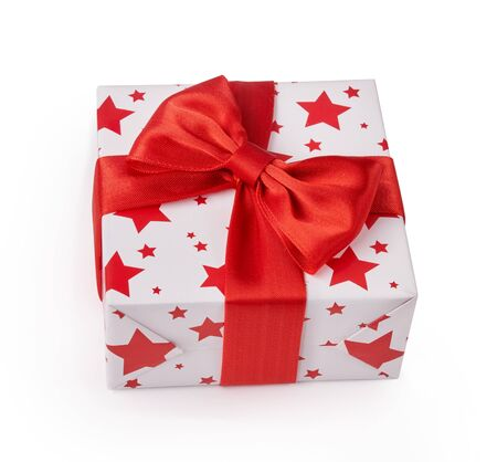 Beautiful white gift box with red bow. Happy Womens Day or Christmas and New Years Day. Top view. Reklamní fotografie