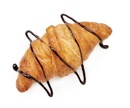 Fresh croissant with chocolate sauce on a white background. Top view. Zdjęcie Seryjne - 137365342