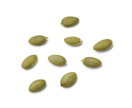 Raw pumpkin seeds isolated on white background. Top view