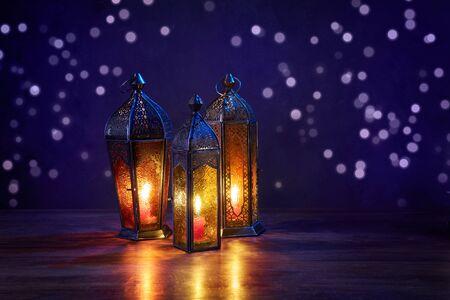 Ramadan lanterns on dark blue background. Greeting Cards for Muslim Holidays. An illuminated Arabic lamp.
