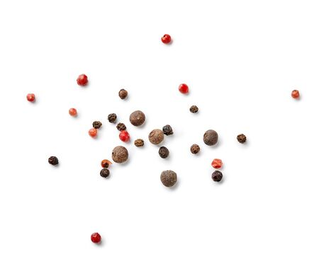 Mix of black and red pepper, pimento isolated on white background. Top view of allspices and spices.
