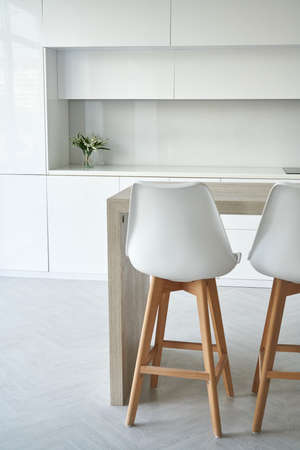 Bright kitchen interior with white chairs style scandinavian