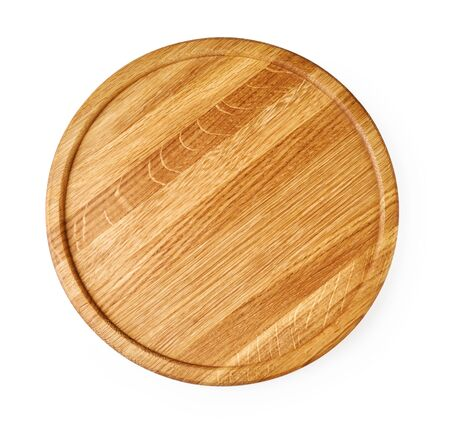 Round wooden board isolated on white background. Top view of chopping board.