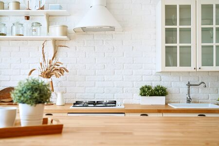 Kitchen wooden table top and kitchen blur background interior style scandinavian