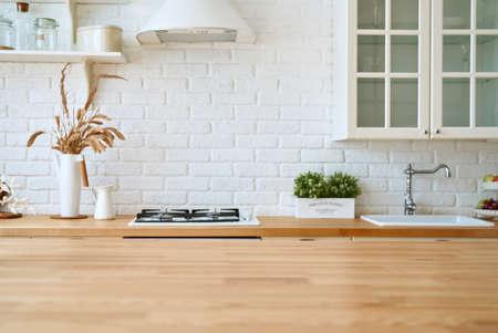 Kitchen wooden table top and kitchen blur background interior style scandinavian Standard-Bild