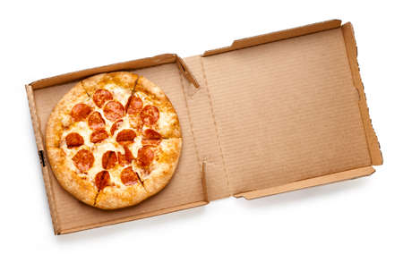 Pizza in a cardboard box isolated on white background. Top view of pizza package.