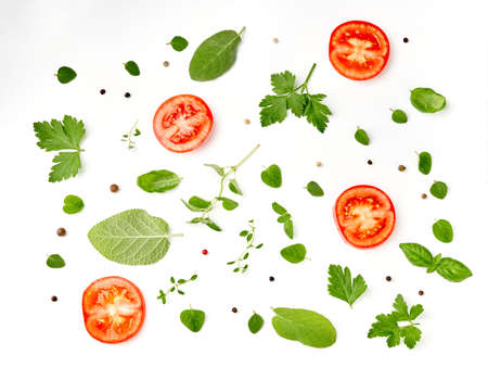 Tomatoes, herbs and basil leaves isolated on white background. Top view. Zdjęcie Seryjne