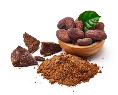 Cocoa beans with cocoa leaf in wooden bowl and cocoa powder with chocolate pieces isolated on white